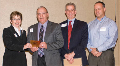 Senior Vice President and Chief Nuclear Officer Larry Weber (second from left) accepts Lake Michigan College's Corporate Partner of the Year Award from LMC Board Chair Judy Truesdell (left); along with LMC President Dr. Robert Harrison (second from right) and Cook Support Services Vice President Mike Carlson (right).