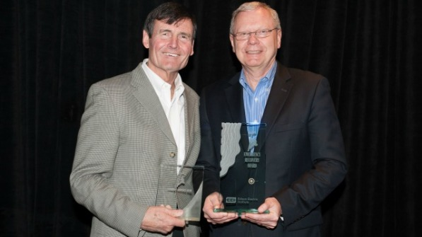 EEI President Tom Kuhn presented the Emergency Recovery Award and Emergency Assistance Award to Bob Powers for AEP's response to the derecho in June and assistance to other utilities during Hurricane Sandy. Photo courtesy of the Edison Electric Institute.