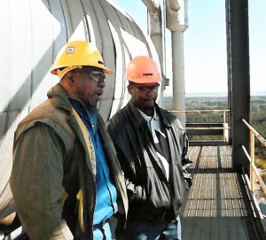 Oliver Jefferson (left) speaks with current Longview Lineman Brandish Haynes at Pirkey Power Plant.