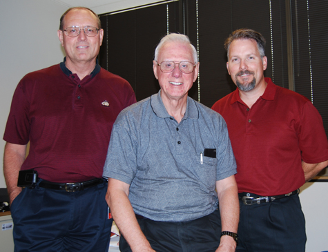 For nearly 50 years, Jack Catlett (center) has been a mainstay of the Transmission/Station group at PSO…for 31 years as an employee and for the past 17 as a retiree/contractor. In that time, he's mentored many young engineers, including the two flanking him in photo. At left, is Rick Gurley, manager-Protection & Control Engineering; at the right is Shawn Robinson, director-Station Engineering.