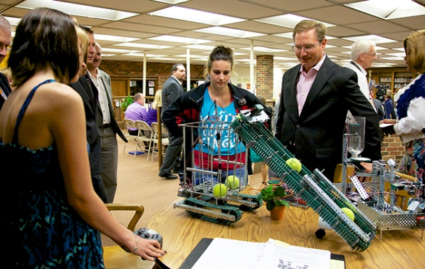 Two West High School female engineering students demonstrate a robotics project to visitors. Photos by Sarah Hunyadi.