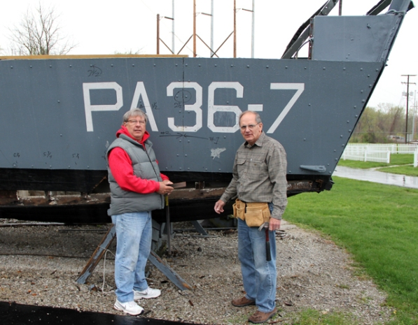 AEP retirees Roger Dyer (left) and Jim Michalec are helping to restore a historic World War II landing craft at the Mott's Military Museum in Groveport, Ohio.