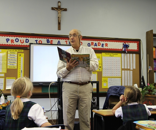 "Jon Atchley, who retired after 30 years with Appalachian Power, reads ""Silver Packages,"" by West Virginia author Cynthia Rylant to students at Our Lady of Fatima Catholic School in Huntington, W.Va., on Read to Me Day 2013. This year's event is scheduled for Nov. 20, 2014. Photo by Allison Barker."