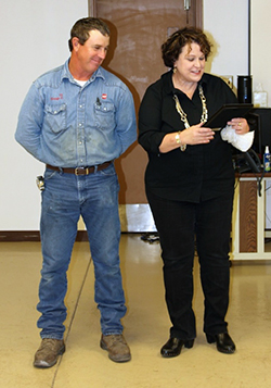 George Craig receives a Good Samaritan Award from Venita McCellon-Allen, SWEPCO president and chief operating officer. Photo by Derrick Taylor.